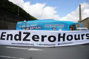 Members of the Unite Union protest against zero hours contracts, outside the launch of the Conservative Party Election Manifesto in Halifax, UK