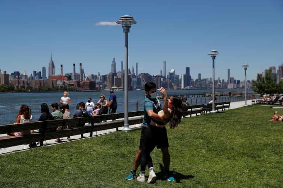 Felipe Beltran, 25, gives a salsa lesson to Brianna Davis, 29, at Domino Park in New York City.