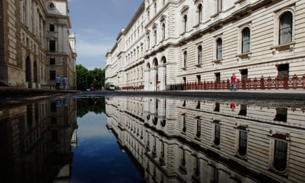 Water pools on the street outside the Foreign and Commonwealth Office in London