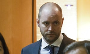 Al-Jazeera journalist Tristan Redman, walks out of court with his lawyers, in Paris.