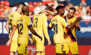 Teammates congratulate Ansu Fati on the goal at Osasuna that made him Barcelona's youngest ever goalscorer