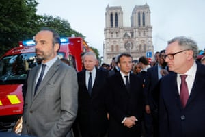 French Prime Minister Edouard Philippe, Minister of Culture Franck Riester and French President Emmanuel Macron gather near the Notre Dame Cathedral as its burns.
