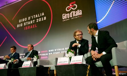 Italy's sport minister, Luca Lotti, talks to the Italian cycling champion Ivan Basso as the full details of the start in Jerusalem were confirmed.