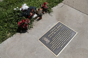 A memorial plaque in the sidewalk near the spot where Michael Brown was shot and killed by a police officer