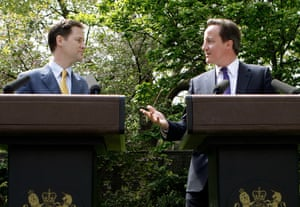 David Cameron and  Nick Clegg hold their first joint press conference in the garden of 10 Downing Street in London, 12 May 2010.