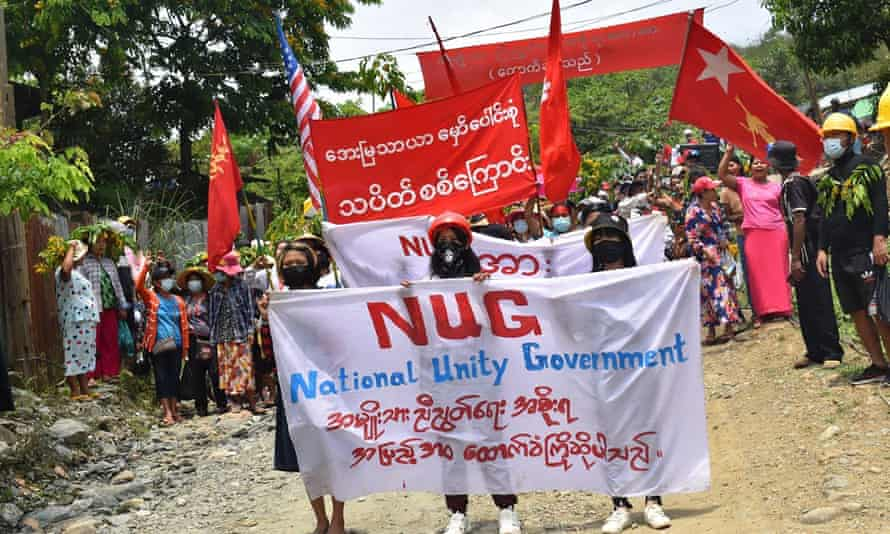 Protesters march with banners supporting Myanmar's opposition National Unity Government on 8 May.