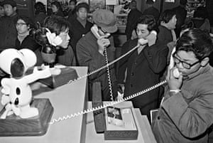 People make long-distance phone calls from an office in Beijing