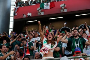 Mexico fans celebrate after Germany concede a goal.