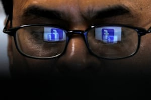 Facebook logo is reflected in glasses