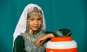 A girl wears traditional jewellery during a rehearsal before the Hazara Culture Day in Mariabad