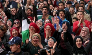 Palestinians celebrate in the West Bank city of Ramallah after primary school teacher Hanan al-Hroub won the Global Teacher prize.