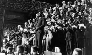 Singing with a choir in a scene from The Proud Valley.