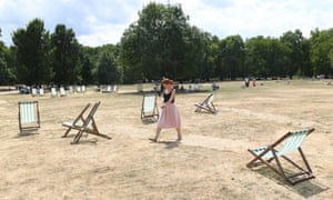 Green Park in London belies its name as extreme heat turns grass brown.