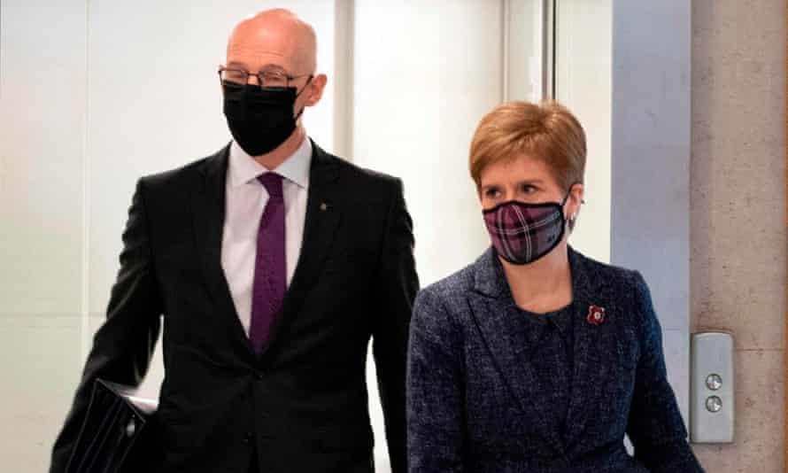 John Swinney and Nicola Sturgeon at the Scottish parliament on Thursday.