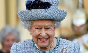A head and shoulders of the Queen in a pale blue hat and suit, smiling