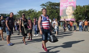Cuban migrants walk toward the Costa Rican border after riot polices fired teargas at the border between Nicaragua and Costa Rica.