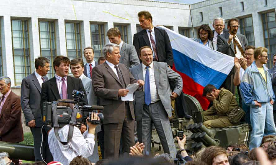 FILE - In this Monday, Aug. 19, 1991 file photo, Boris Yeltsin, president of the Russian Federation, makes a speech in front of the Russian parliament building in Moscow, Russia, 19 August 1991.