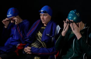 Sarah Sjostrom of Sweden (centre) the current Olympic 100m butterfly champion and multiple world record holder, waiting to compete in the women's 100m butterfly for Energy Standard next to teammate Anastasiya Shkurdai of Belarus (left) and Marie Wattel of France and London Roar.