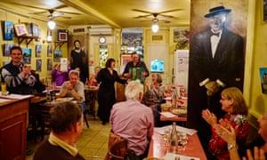 A singer and accordion player entertain guests at Restaurant Le Vieux Belleville, 12 rue Envierges, 75020 Paris, France