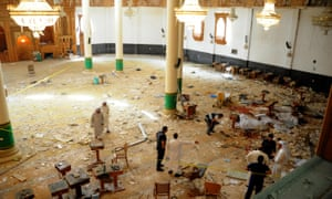 Mosque officials inspect the damage at the al-Imam al-Sadiq after a deadly attack by Isis.