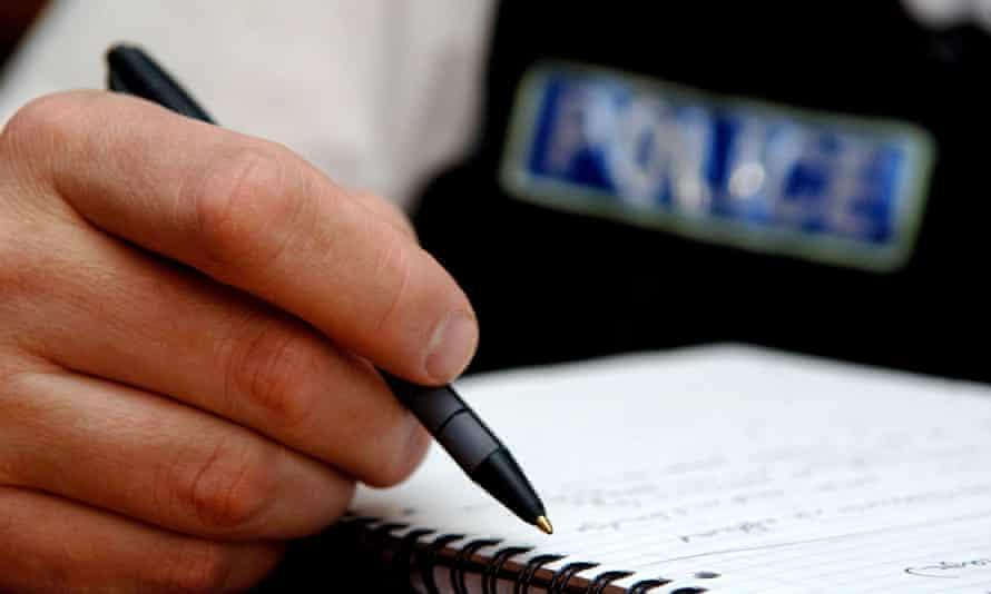Policeman making notes.