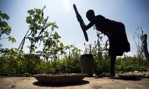 A woman mills sorghum from her family's land in northern Bahr El-Ghazal in a drought-stricken South Sudan in 2015.