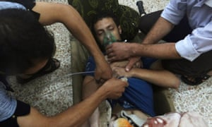 A man being treated after what activists claimed  was a nerve gas attack in the Damascus suburbs of Jesreen in August 2013