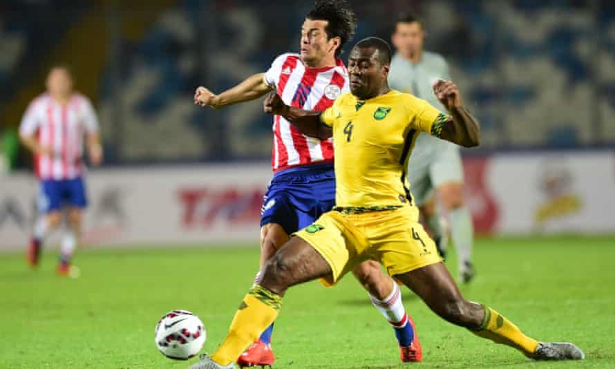 Wes Morgan tackles Nelson Haedo Valdez during Jamaica's match against Paraguay at last year's Copa America