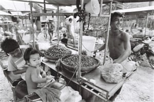 Pov sells snails from his stall. On a good day he can sell 60kg of steamed and seasoned snails.