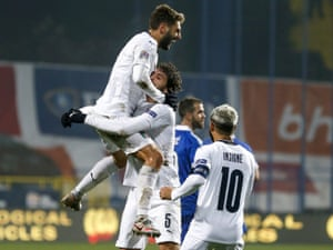 Domenico Berardi (L) of Italy celebrates after scoring to make it 2-0.