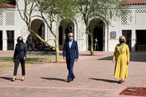 Kamala Harris, Joe Biden and Cindy McCain walk to the American Indian Veterans National Memorial at the Heard Museum, 8 October 2020, in Phoenix.