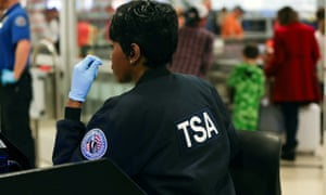 A TSA agent screens passengers at a security checkpoint amid the government shutdown in Atlanta, Georgia on 18 January.