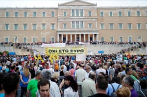 "ATHENS, GREECE - JUNE 21: Protesters attend with a banner saing ""No to Euro"" on an anti-austerity pro-government rally in front of the parliament building on June 21, 2015 in Athens, Greece. Greece's leftwing government believes it can reach a deal with its creditors on Monday. (Photo by Milos Bicanski/Getty Images)"