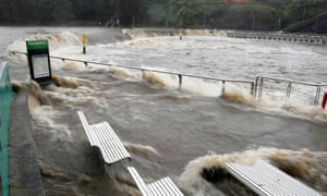 The swollen Parramatta River is seen overflowing as NSW experiences heavy rains