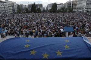 Demonstrators take part in a rally demanding that Greece remains in the Eurozone, outside the parliament in Athens, Greece, 18 June 2015.