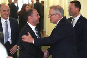 Scott Morrison and Frydenberg shake hands after emerging victorious following the party room meeting