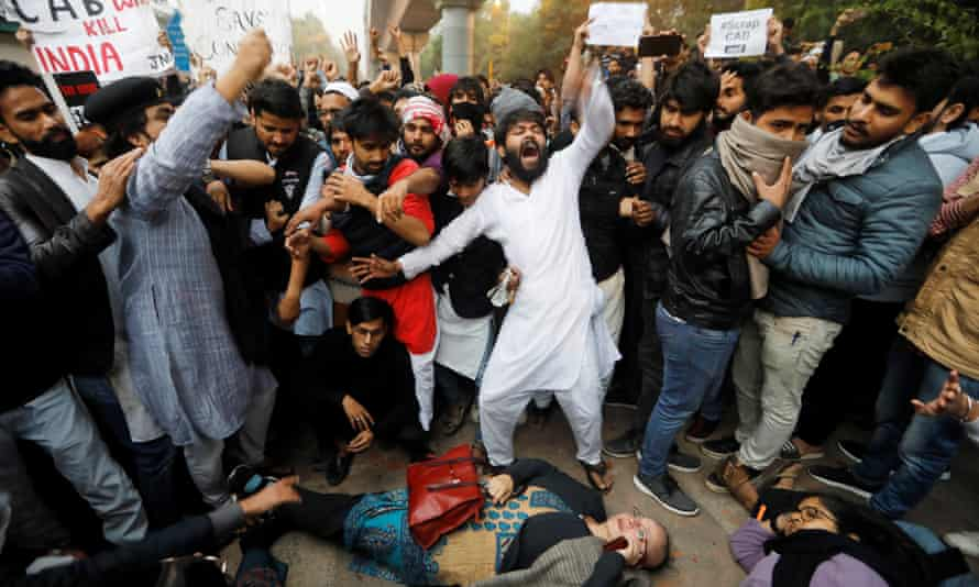 Protestors shout slogans during a protest against the citizenship bill in New Delhi.