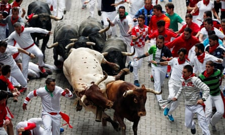 Bulls charge through the streets of Pamplona on the last day of the annual San Fermín festival
