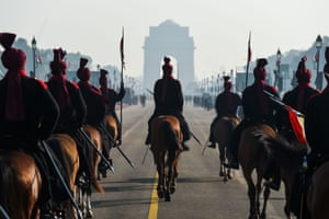 Soldiers ride towards the India Gate monument in New Delhi