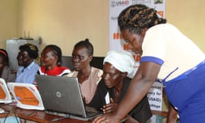 Mary Namukholi, right, conducts an evening class at a local ICT hub located in Nambalayi primary schoo, Kenya