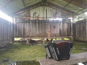 An accordion is on a bench inside the improvised temple where a pregnant woman, five of her children and a neighbour were killed by cult members in the remote hamlet of Alto Terrón, Panama