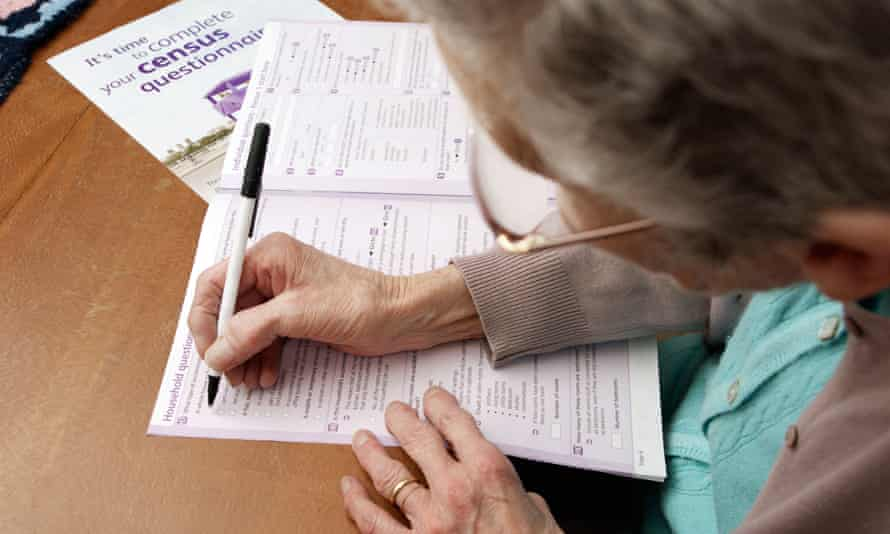woman filling out census form