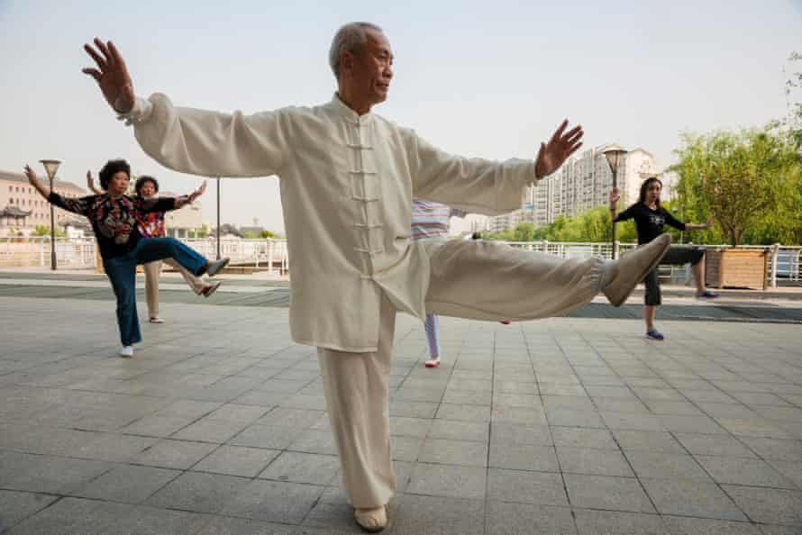 An elderly man practices Tai Chi in Grand Canal Park