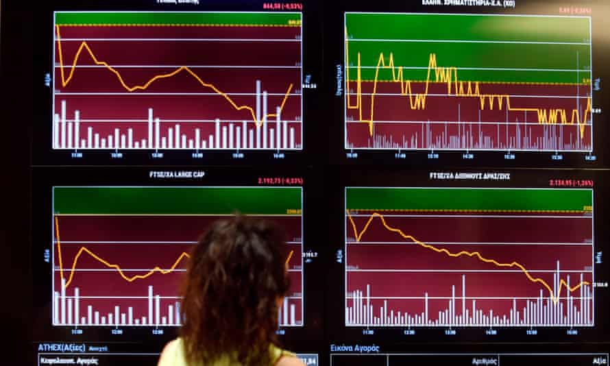Stock prices on a screen at the Athens Stock Exchange
