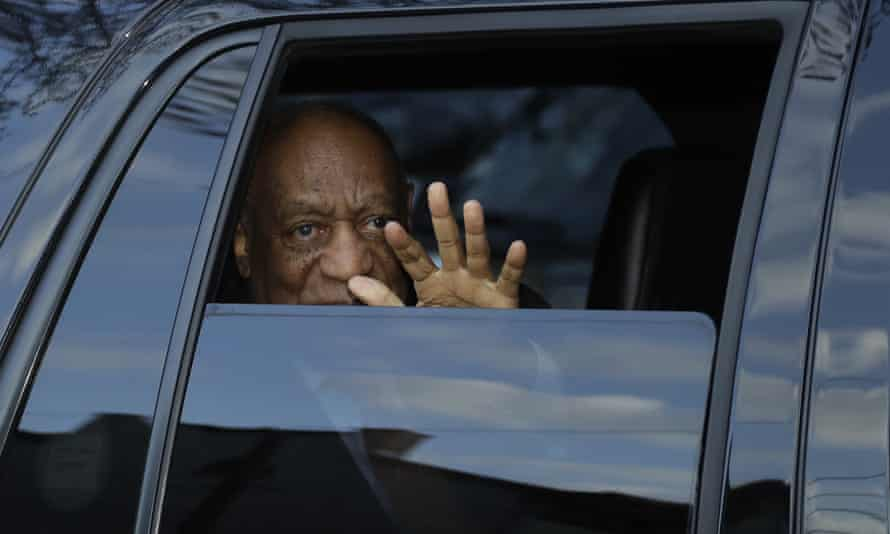 Bill Cosby waves as he departs after his sexual assault trial on Tuesday.