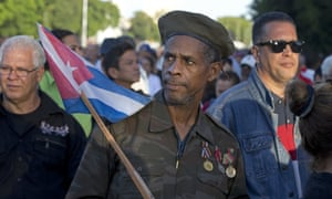 Ernesto Barbon, a veteran of the Angola war where Cuban troops fought in the 80s, waits in line to enter the Plaza de la Revolución, to render homage to Fidel Castro on Monday.