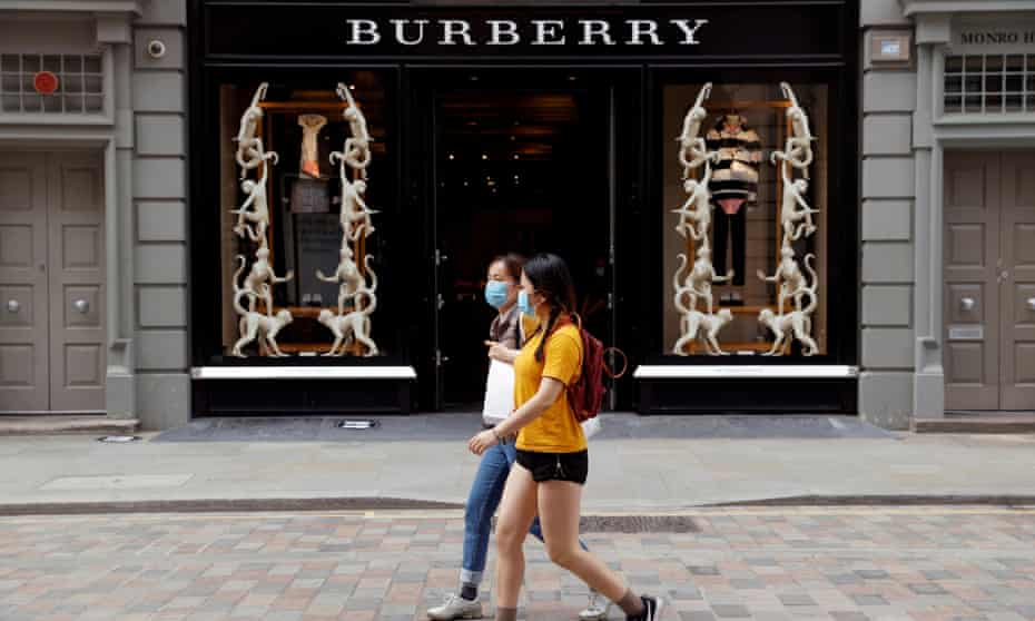 People walk past a Burberry store in Covent Garden, London.