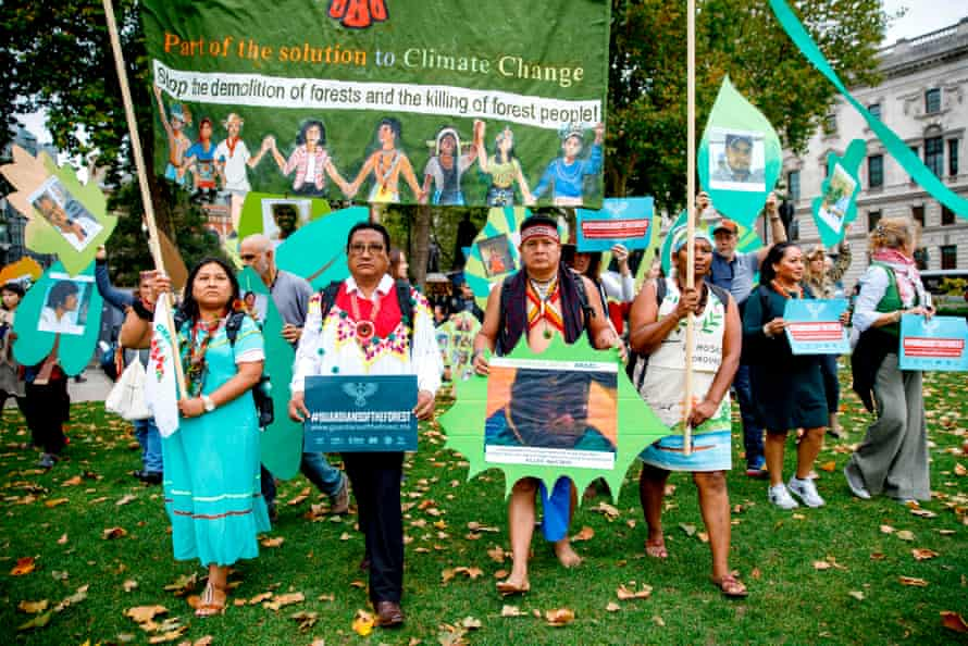 Members of a delegation of indigenous and rural community leaders from 14 countries in Latin America and Indonesia, the Guardians of the Forest campaign, demonstrate against deforestation in London.
