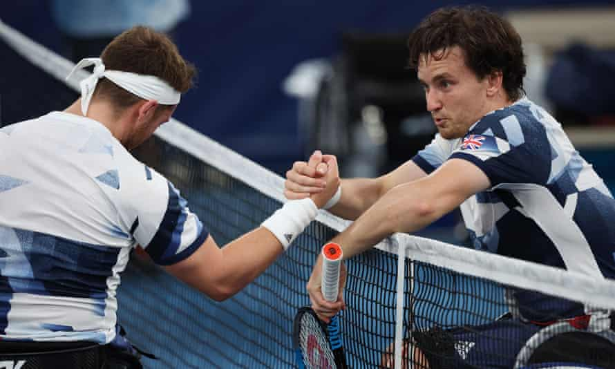 Gordon Reid (right) and Alfie Hewett shake hands at the net after the match.