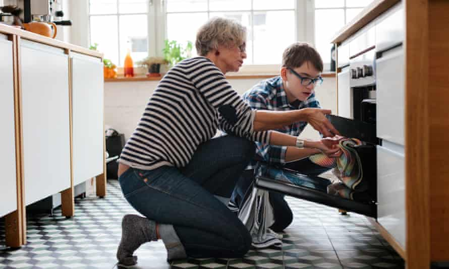 Mother teaching her teenage Son how to cook